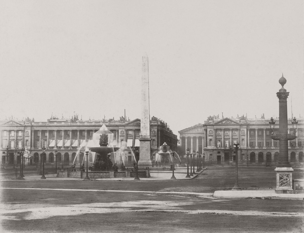 Photograph shows obelisk and fountain in Place de la Concorde with palaces, Rue Royale, and Church of the Madeleine in the background. 1865.