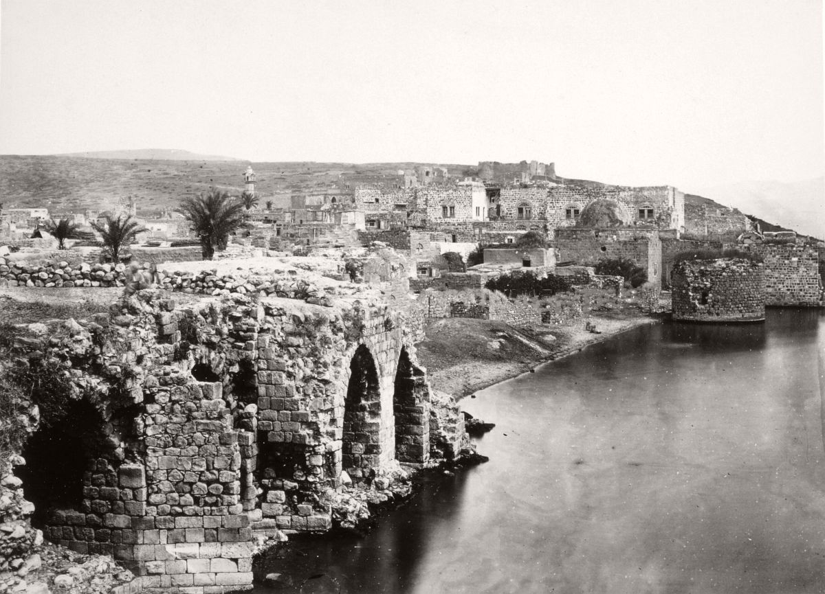 Tiberias from the south showing ruins of a sea-wall and Roman masonry along the shore of the lake. 1862.