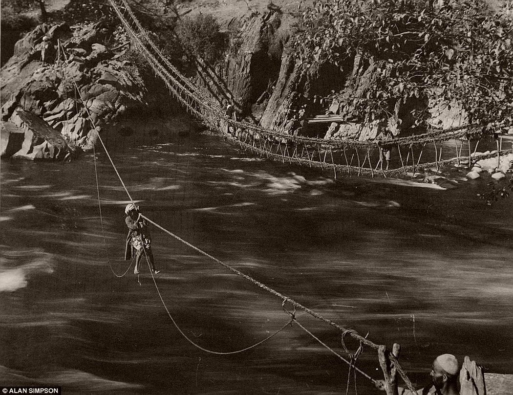 A man uses a rope to cross the River Jheulum in Kashmir in 1896.