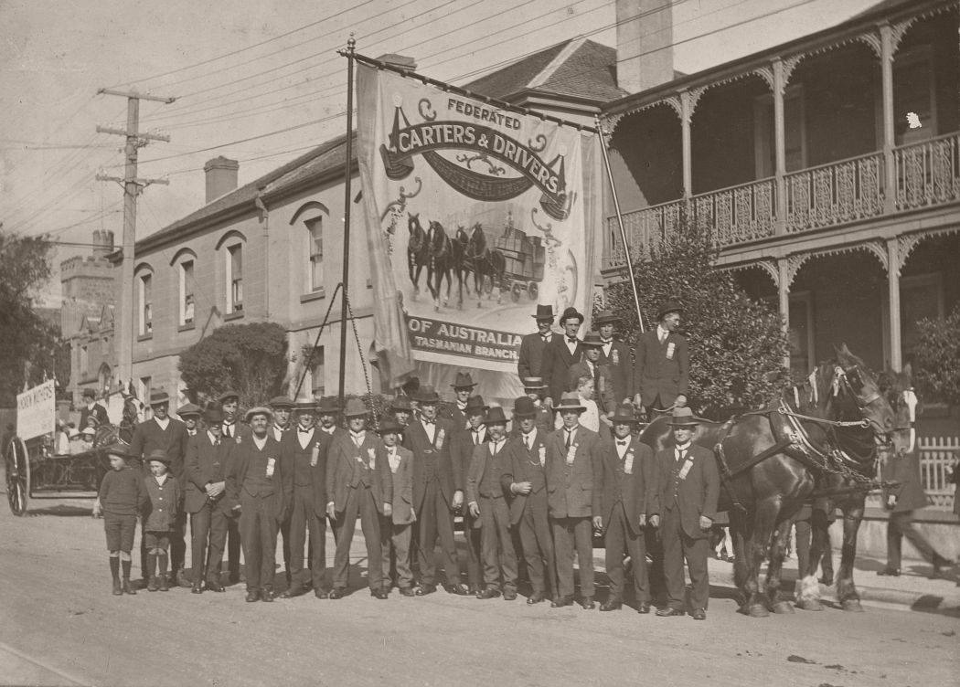 A photograph of members of the Tasmanian branch of the Federated Carters and Drivers Industrial Union of Australia gathered for a Eight Hour Day Parade, circa 1920.