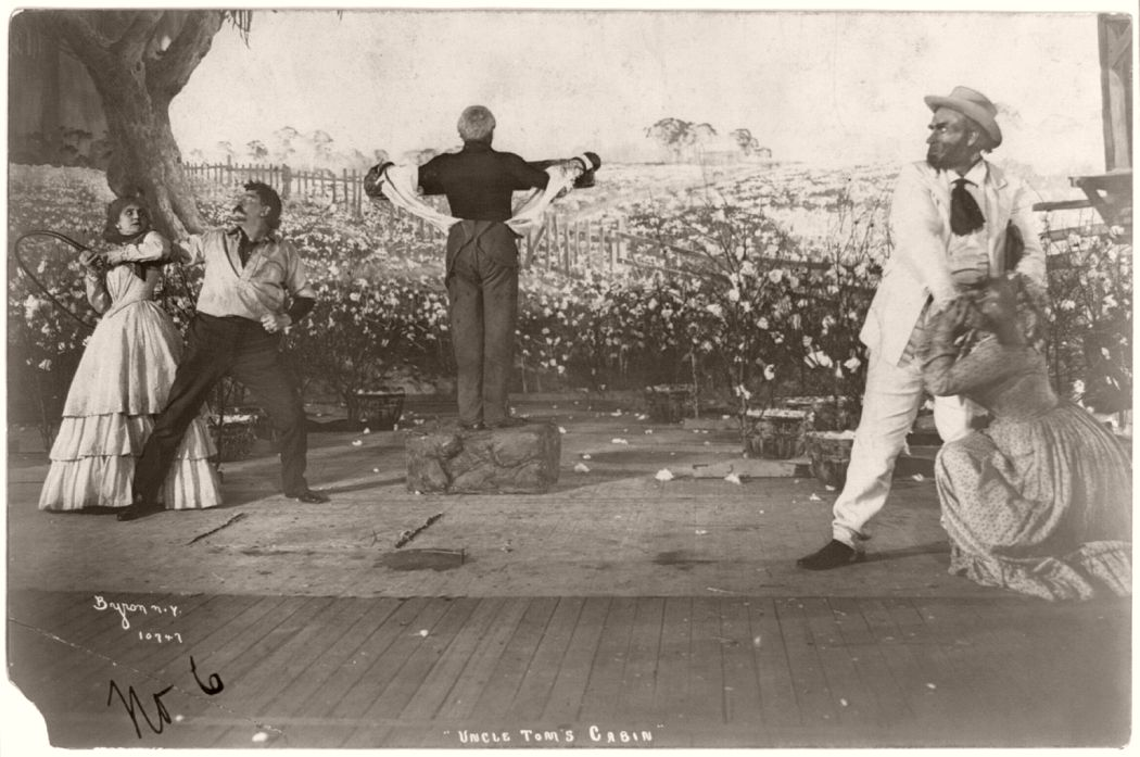 """Uncle Tom at the whipping post"", scene from Uncle Tom's Cabin, early twentieth century stage production. 1901."