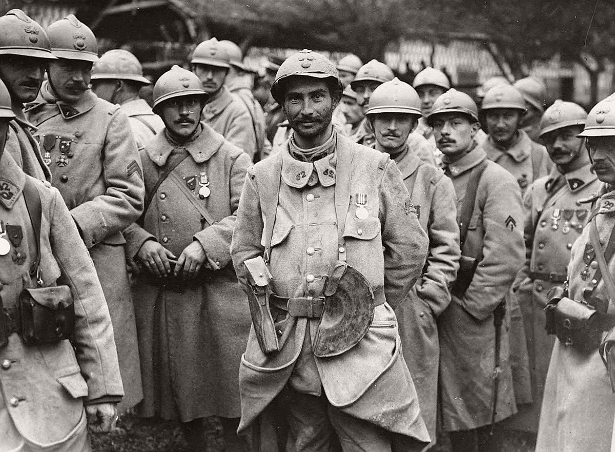 French soldiers stand in a relaxed group wearing medals. The medals appear to be the Military Medal, established on 25th March, 1916, for acts of bravery. They have probably been awarded for their part in the Battle of the Somme. The French helmets, with their very distinct crests, can be seen clearly. # National Library of Scotland