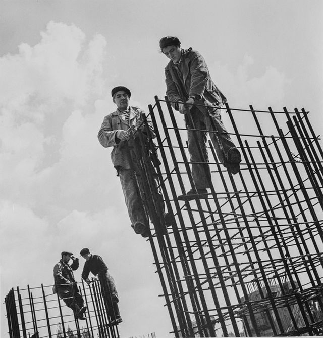 """Construction Workers with Rebar Towers,"" silver gelatin print by Dmitri Baltermants. Bowdoin College Museum of Art."