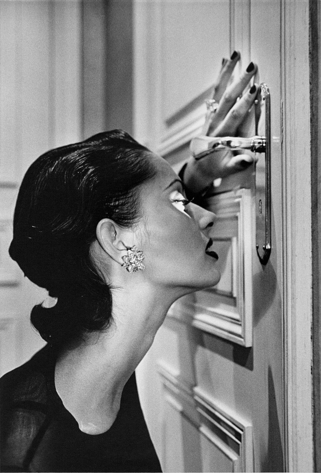Helmut Newton Heather looking through a keyhole, 1994 © Helmut Newton Estate