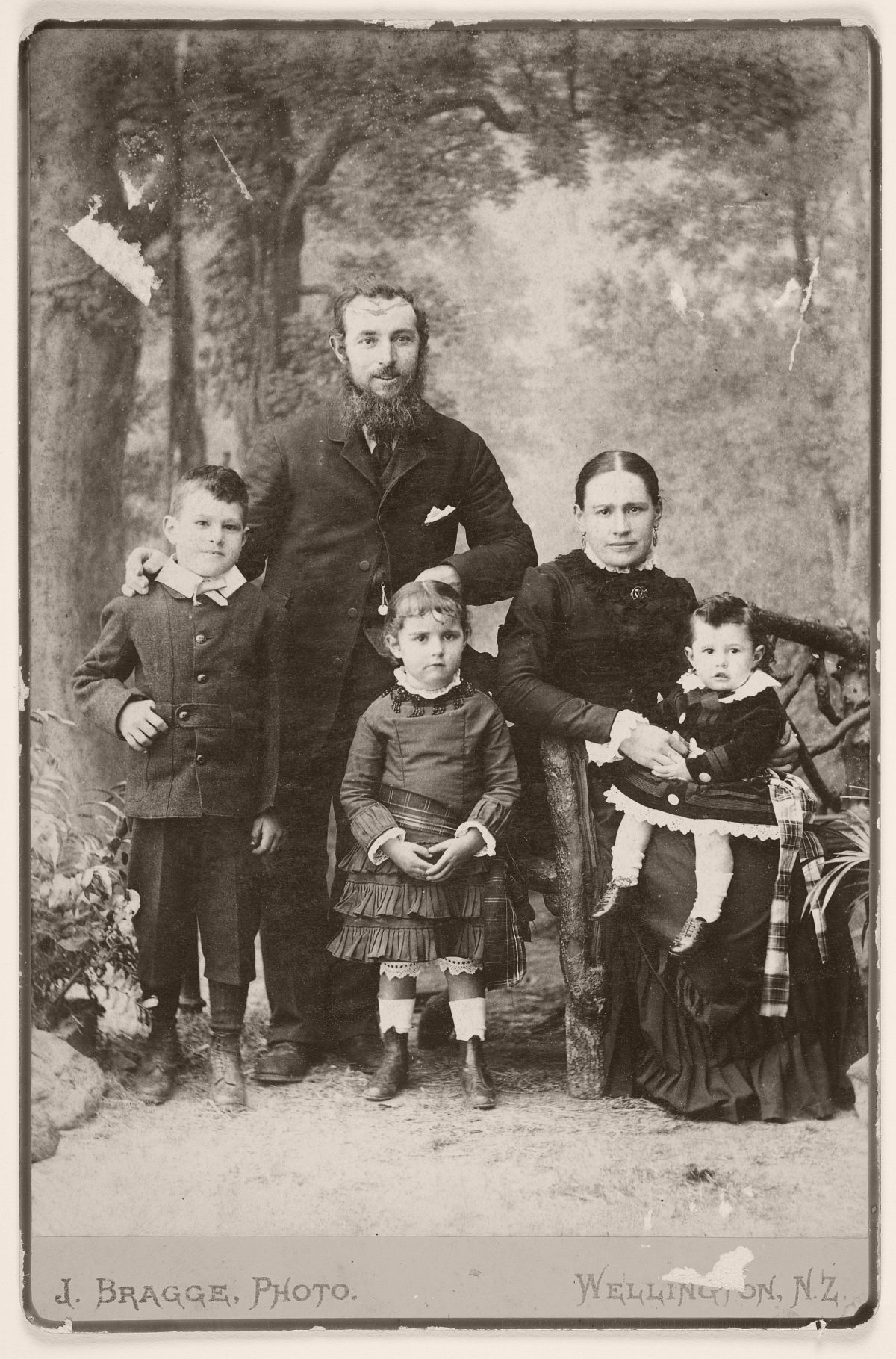 Man and woman with three children, 1880.