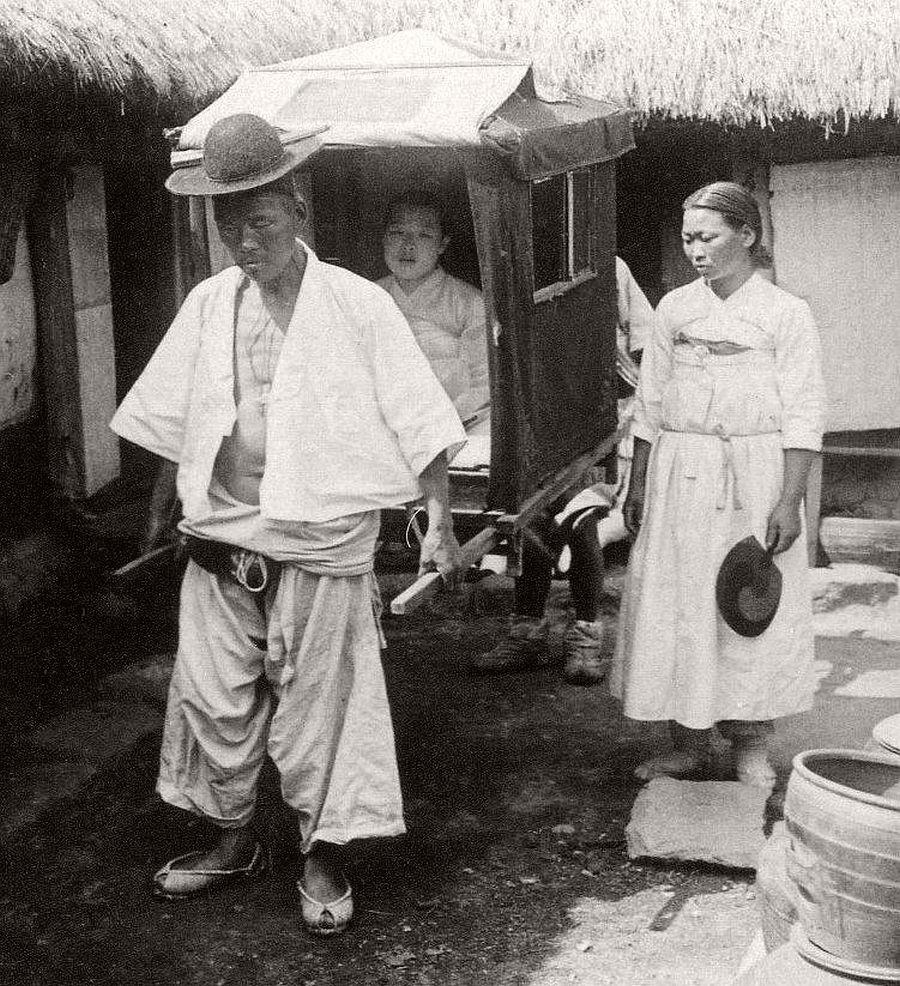 Ready to roll, a high-class girl rides, her servant walks, Seoul, ca. 1900