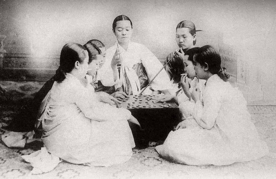 Smoking, gambling, and gossiping, ca. 1900
