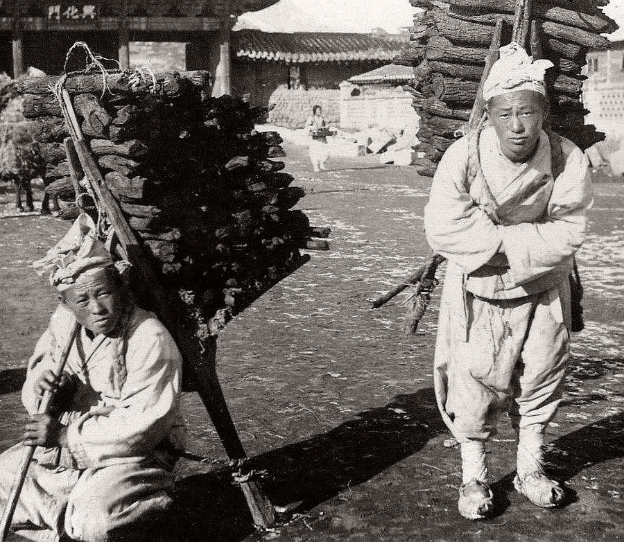 Charcoal carriers, Seoul, ca. 1900