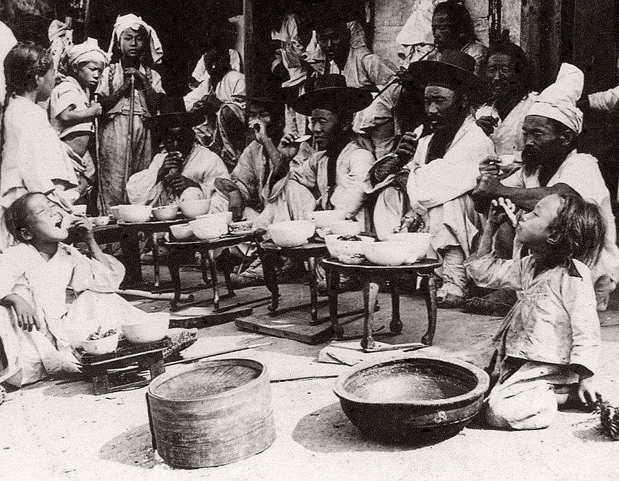 Chowing down at an old 'greasy spoon' where the food tastes great, Seoul, ca. 1900