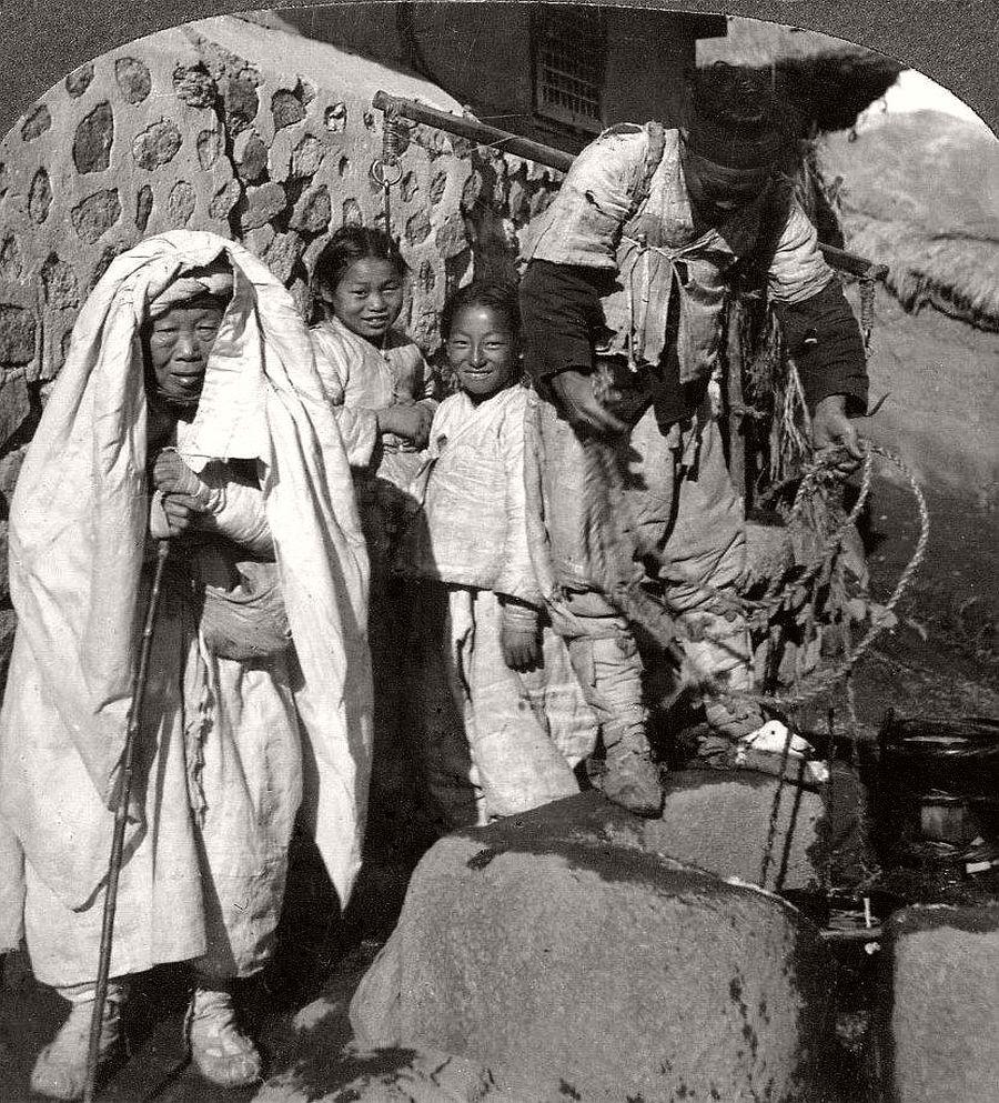 Happy kids with grandma and the water boy, Seoul, ca. 1900
