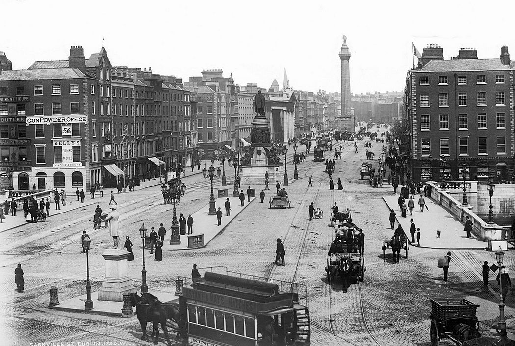 Great view of a bustling O'Connell Bridge and Sackville Street (now O'Connell Street) in Dublin, 1890