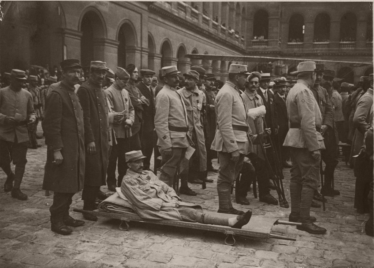 1915. An award ceremony in the courtyard of Les Invalides. A legless soldier on a stretcher.
