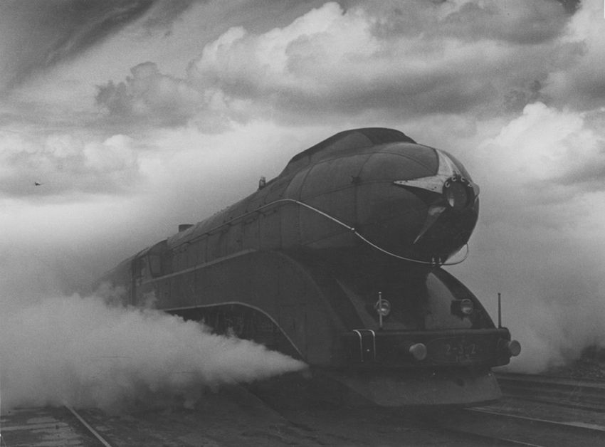 Arkady Shaikhet (1898-1959). Express, 1939. This photograph is an embodiment of dynamism, a symbol of the new Soviet society moving towards a bright future. The steam conceals the wheels and the engine appears almost like a dirigible about to take off. The sky is superimposed for a more dramatic effect. Published in Soviet Photo #2 in 1940, this photograph became one of the greatest achievements of Soviet photography. Soviet design in the late 1930s cannot be imagined without the Soviet metro, aviation and this Express engine.