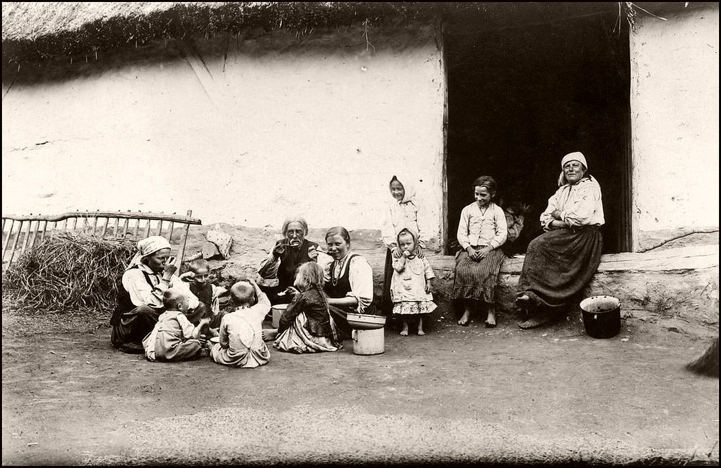 A Polish peasant family eating their midday bread