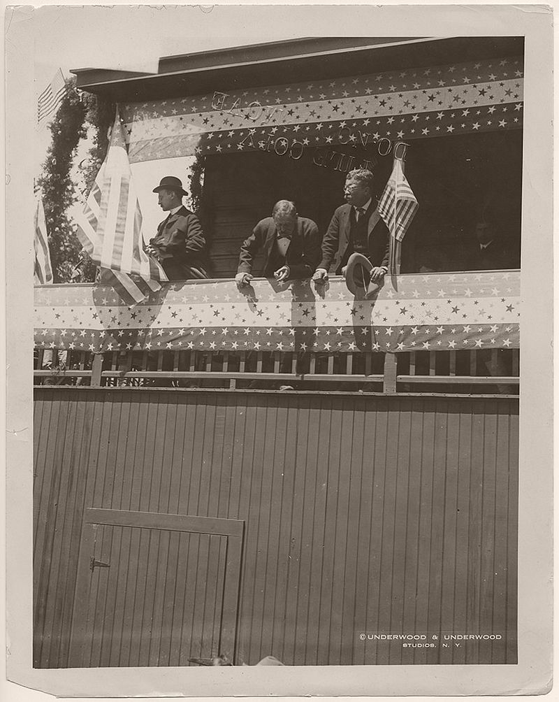 The men in the photograph are, from left to right, William Loeb, Jr., Secretary to the President, Alexander Oswald Brodie, Governor of the Territory of Arizona, and President Theodore Roosevelt. On May 6, 1903, President Theodore Roosevelt delivered a speech at the Grand Canyon in Arizona asking the citizens not to change the land, but to keep it for future generations to see.