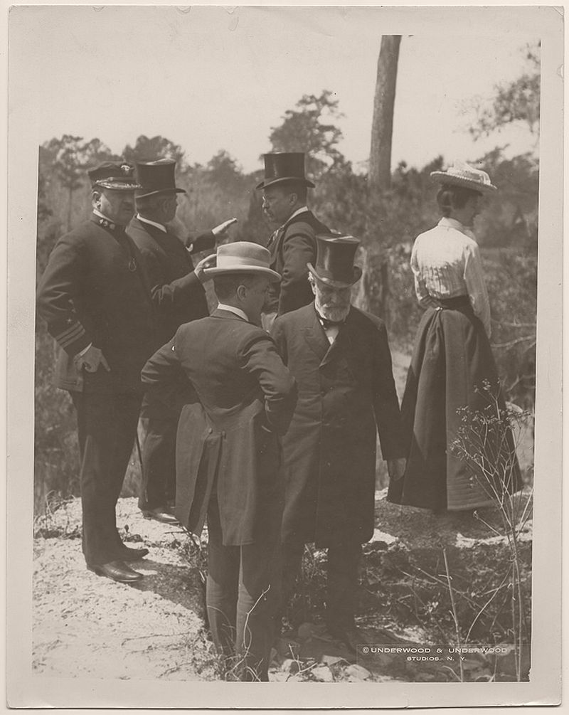 Theodore Roosevelt and other members of the presidential party, at the ruins of Fort Dorchester, a tabby fort constructed in 1757 for munitions storage. The figures in the foreground, left to right, are George B. Cortelyou, Presidential Cabinet Secretary, and James Wilson, Secretary of Agriculture. In the background, left to right, are an unidentified Navy lieutenant, an unidentified man, President Theodore Roosevelt, and Edith Carow Roosevelt. Old Dorchester, Dorchester County, South Carolina. April 9, 1902.