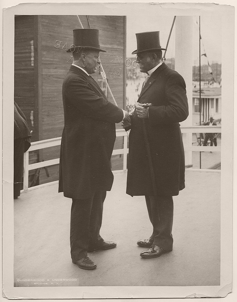 President Theodore Roosevelt shaking hands with Clinton B. Sears, president of the Mississippi River Commission, on the steamboat the USS Mississippi. October 4, 1907.