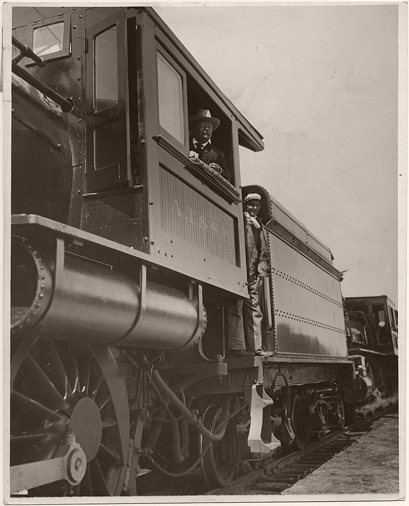 President Theodore Roosevelt posing in the cab of his locomotive, while campaigning for re-election, ca. May 1903. During 1903, Theodore Roosevelt went on an eight-week tour of the Western United States, visiting 25 states, and covering 14,000 miles.