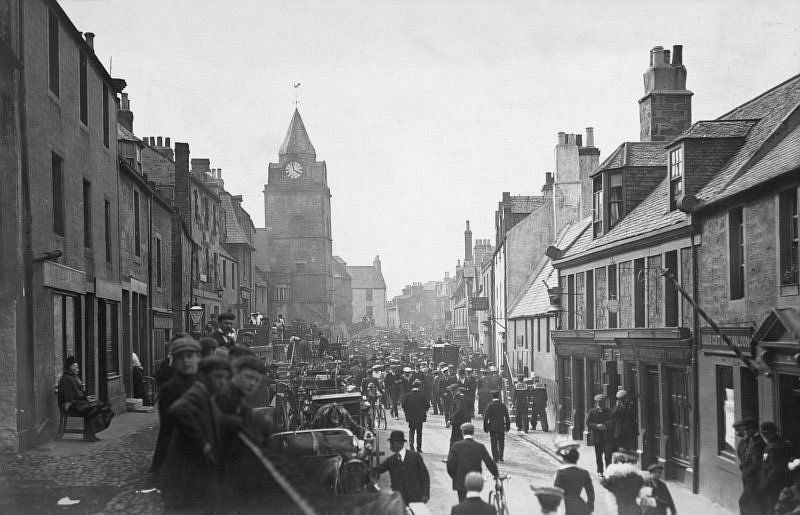 View of High Street, South Queensferry, 1907. Titled: 'South Queensferry, 'Channel Fleet visit 1907'.