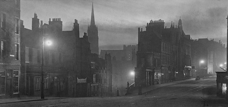 View of Edinburgh at night, 1907. Titled: 'Candlemakers Row and George IV Bridge April 1907'.