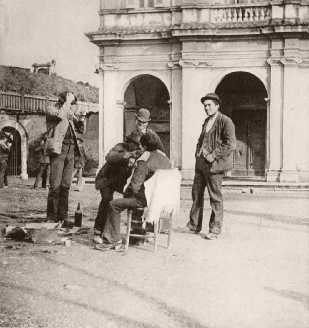 Barber outside Santa Bibiana church, ca. 1890. Photo by Giuseppe Primoli