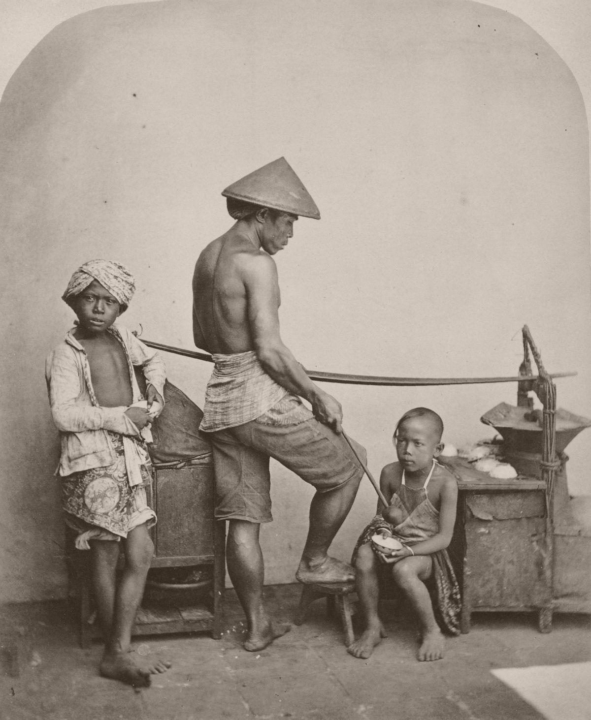 Seller of food on Java, circa 1865.