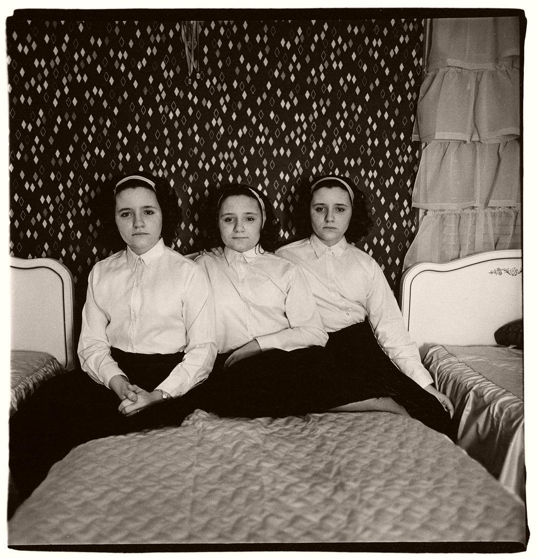 Triplets in their Bedroom, N.J., 1963 by Diane Arbus