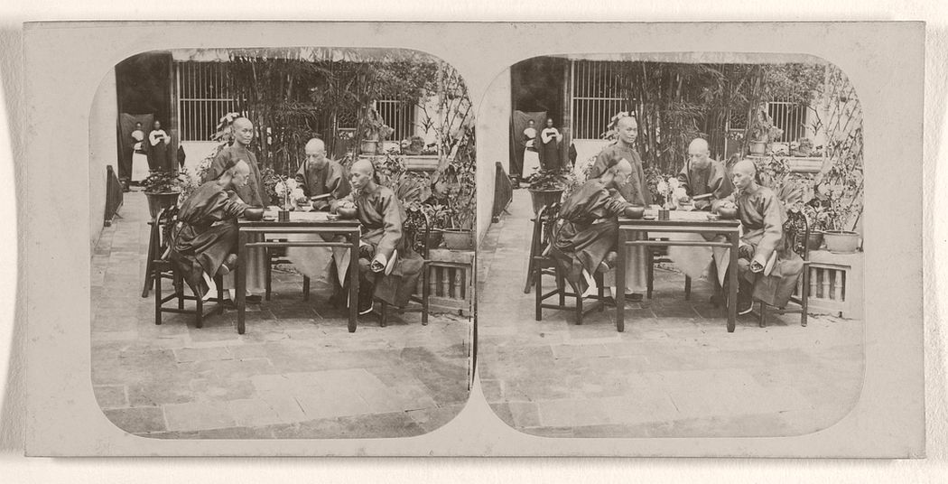 Mandarins playing a Game somewhat similar to Draughts, in the Garden of the Governor of Canton, China.