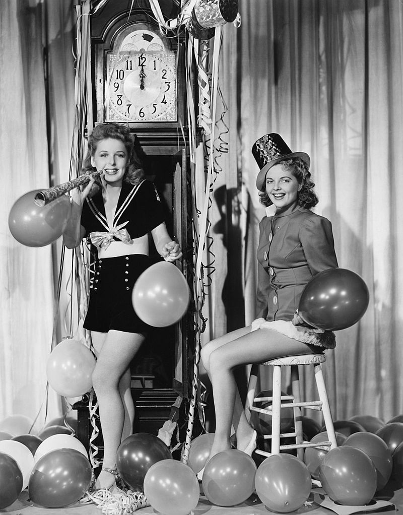 Women with balloons on New Years Eve.