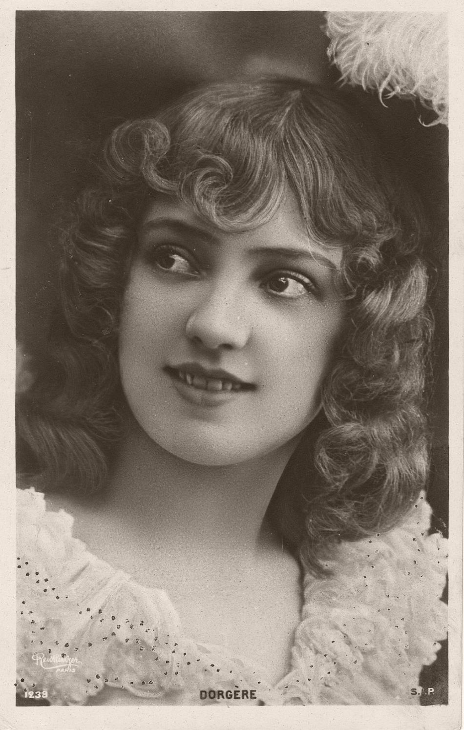 Arlette Dorgère (born Anna Mathilde Irma Jouve; 1880 – 1965) was a French actress, dancer and singer. She was represented on a large number of postcards of the Belle Époque and also a model for posters.