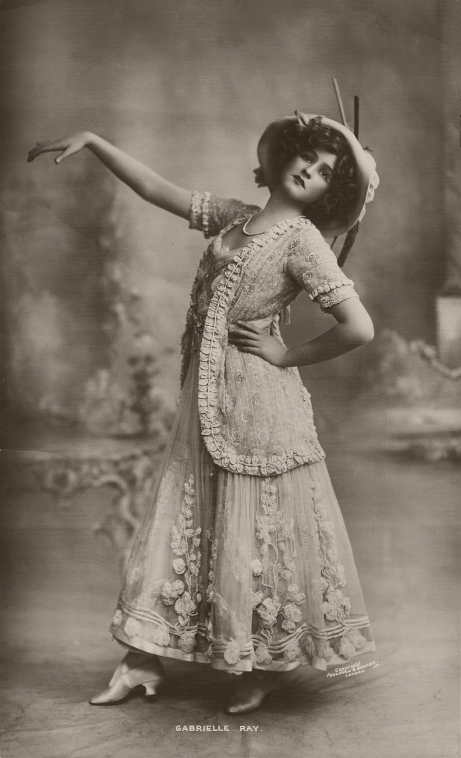 Gabrielle Ray (1883 - 1973), was an English stage actress, dancer and singer, best known for her roles in Edwardian musical comedies.  Ray was considered one of the most beautiful actresses on the London stage and became one of the most photographed women in the world. In the first decade of the 20th century, she had a good career in musical theatre. After an unsuccessful marriage, however, she never recovered the fame that she had enjoyed. She spent many of her later years in mental hospitals.