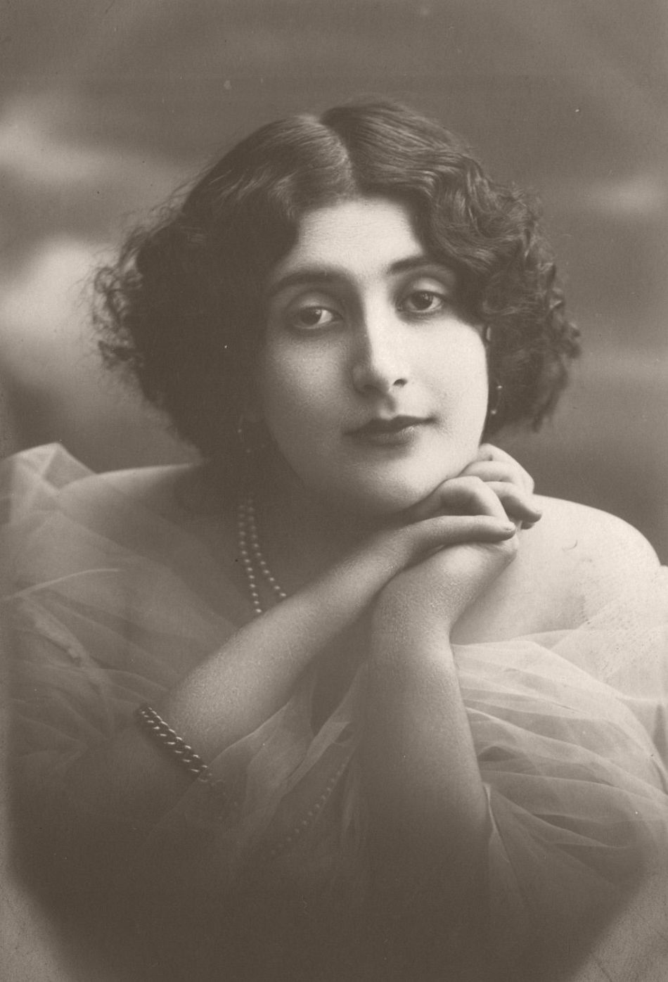 Lina Cavalieri (1875 – 1944) was born near Rome, orphaned at 15, her voice and beauty quickly made her an opera star. Retiring from the stage in 1914, she opened a beauty salon in Paris, and became a film actor in Italy until WWI when she moved to the USA to make more films.