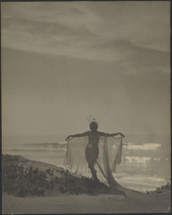 Back View of a Dancer Wearing a Sheer Costume at the Beach, 1920