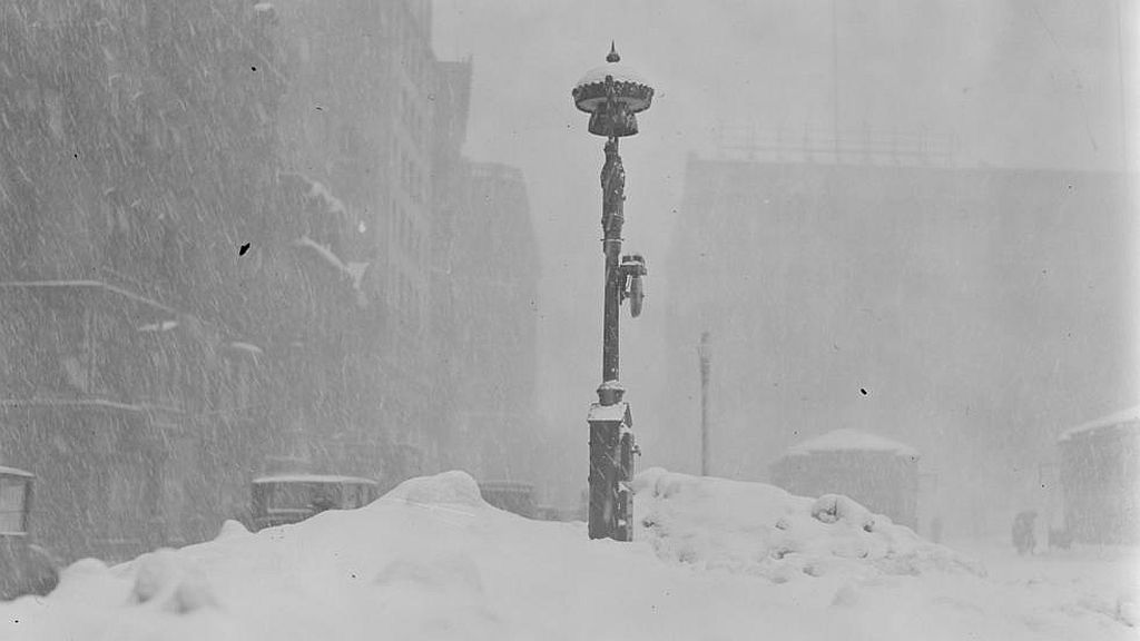 Circa 1923. Fire alarm box almost covered up by snow after severe snowstorm.