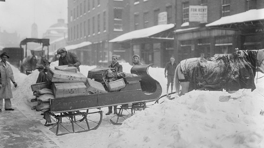 Circa 1910s. Horse-drawn sleigh for hauling goods, market district.