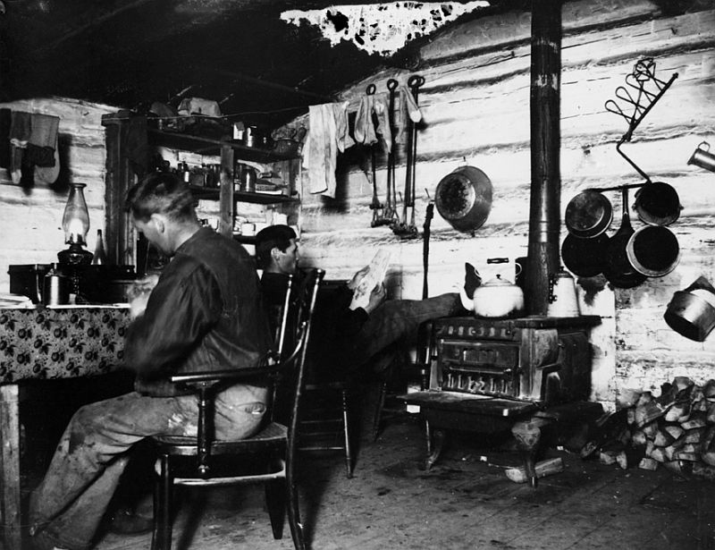 Bruce and Jim Hunter in homestead shack, Dog Pound area, Alberta, 1897