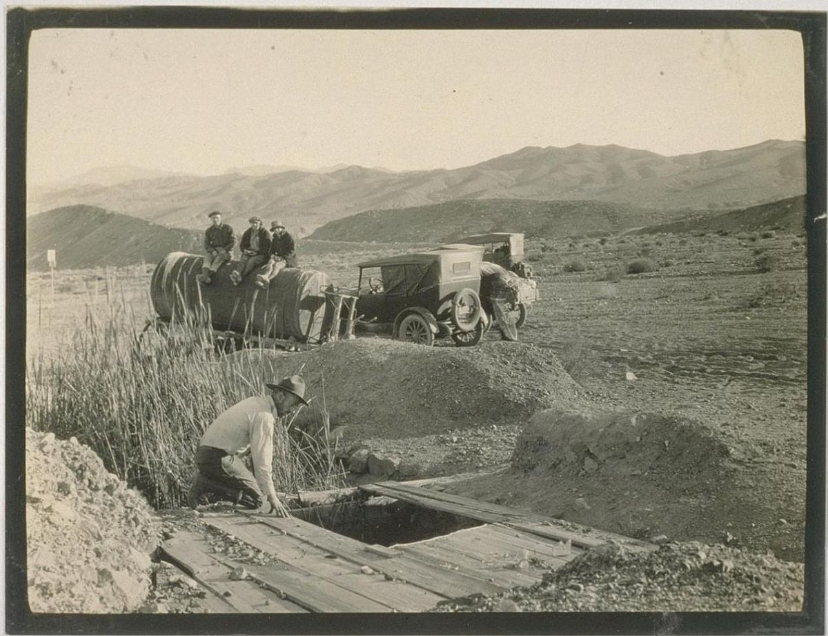 We arrive at Owl Springs, here an abandoned water wagon was found the front wheels sunk in sand, the rear ones almost all cut away by desert wanderers for fire wood; Owl Springs -- one of the water holes of the twenty mule team borax days.