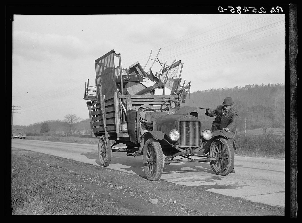 Tenant farmer moving his household goods to a new farm. Hamilton County, Tennessee, 1937.