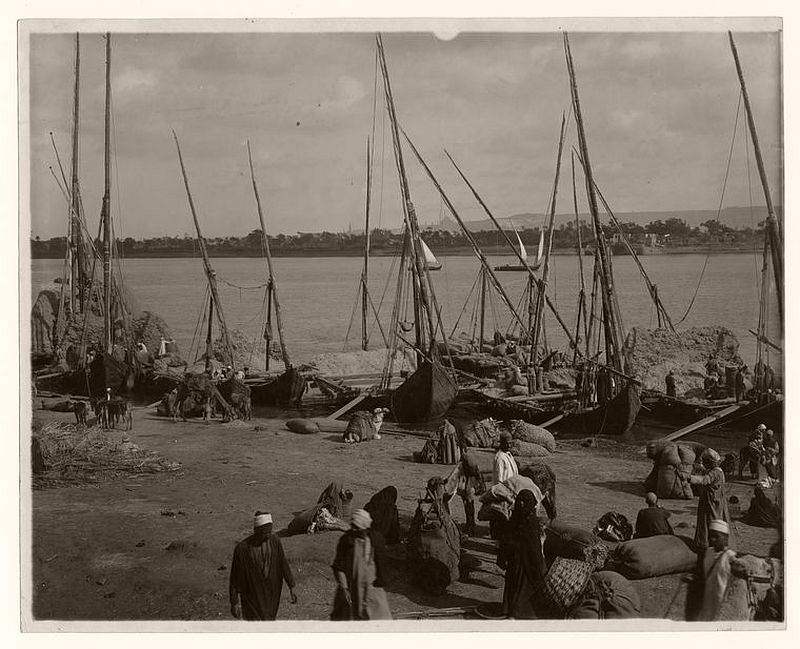 Feed boats (trodden straw) unloading on the Nile, Egypt