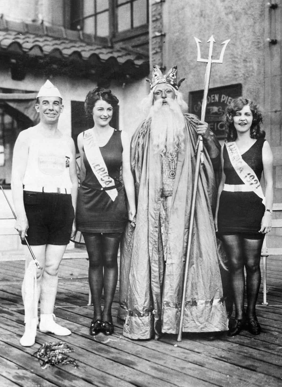 1922 - Gorman, far right, poses with Neptune, pageant director Armand T. Nichols, and her successor, 1922 Miss America Mary Campbell.