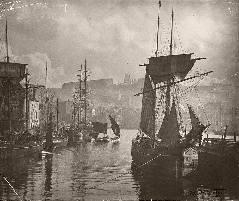 The harbor of Whitby with sailboats