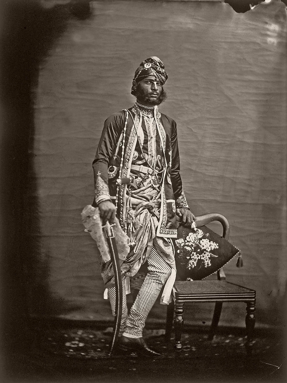Full portrait of a noteworthy man in the royal palace of Jaipur, India, 1857–1865 (Photo by Maharaja Ram Singh III/Alinari via Getty Images)