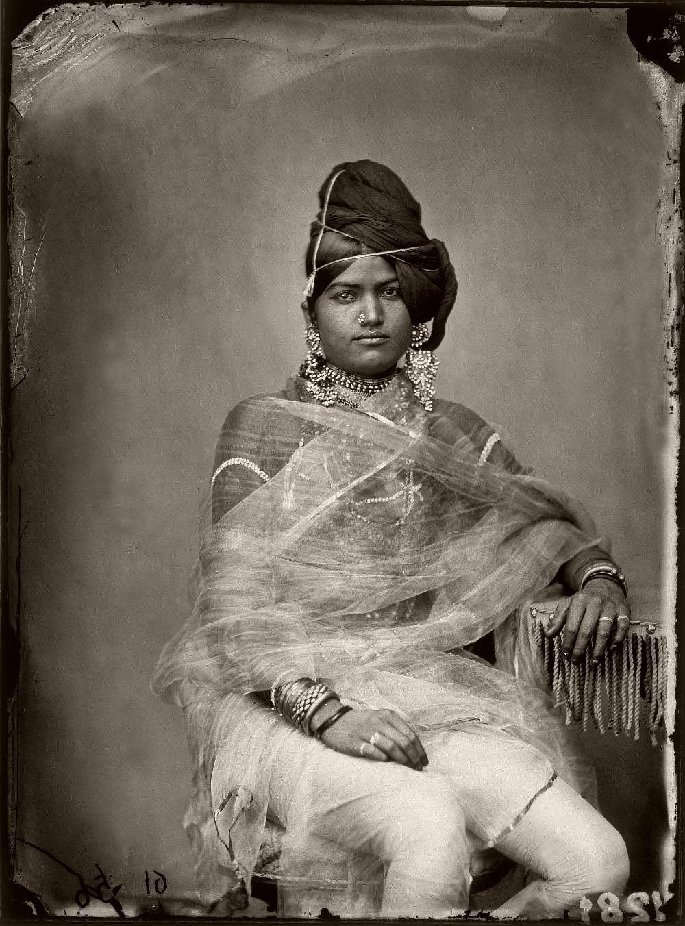 Portrait of a woman in the harem of the royal palace of Jaipur, India, circa 1857. (Photo by Maharaja Ram Singh III/Alinari Archives, Florence/Alinari via Getty Images)