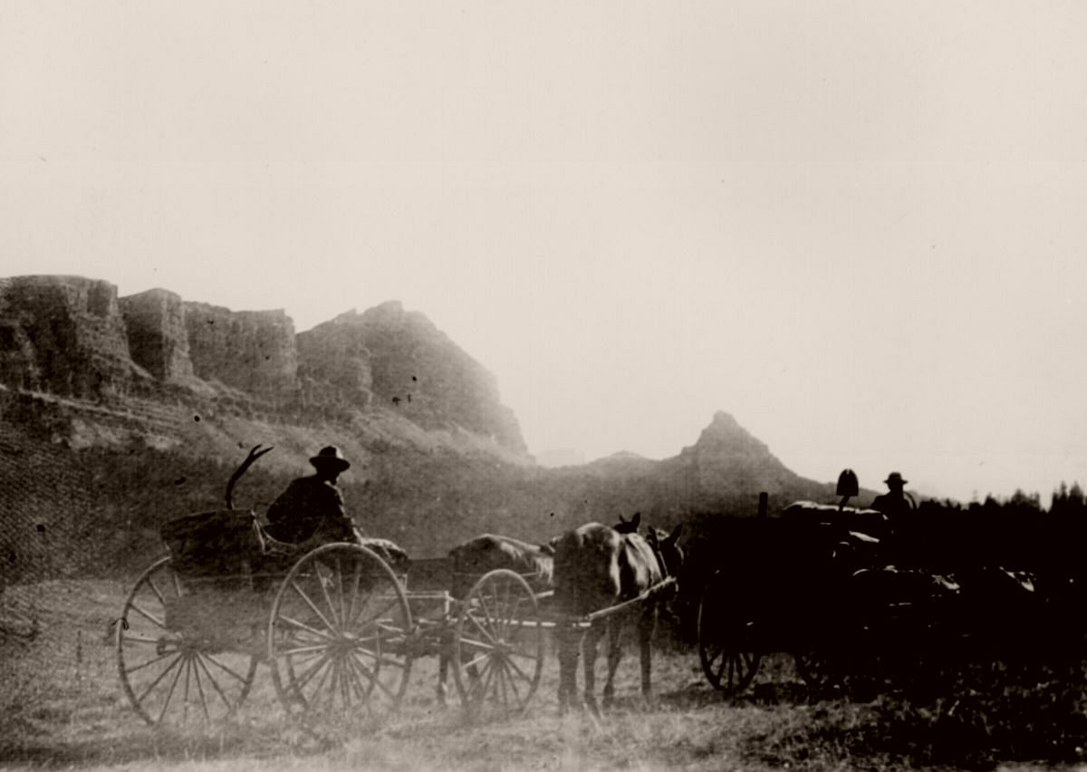 Construction workers on the military road, from Fort Washakie to Buffalo Fork near the Continental Divide, drive their wagonload of equipment up the summit of To-Gwo-Tee Pass, Wyo. Terr., 1898.