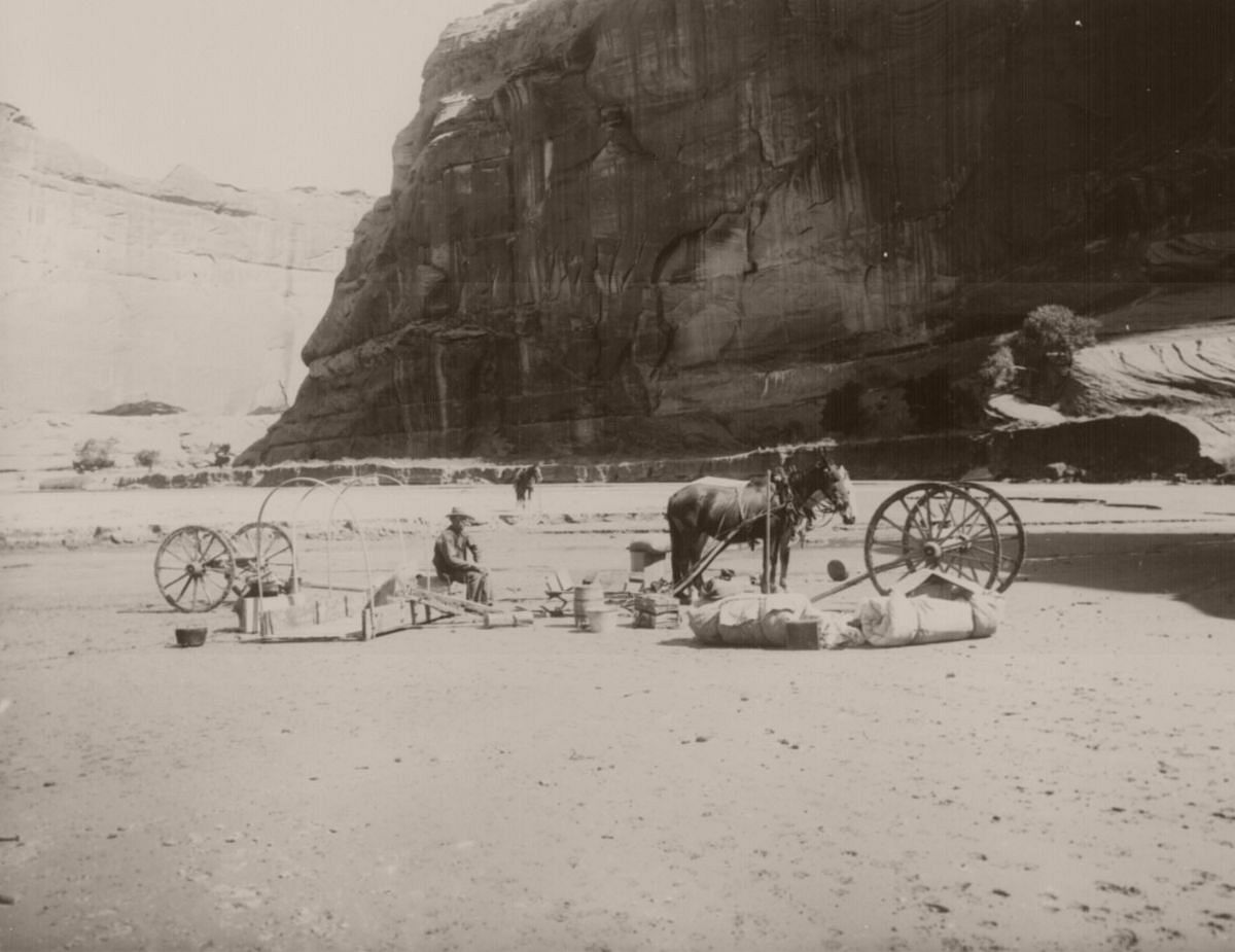 Man with parts of his wagon and equipment on muddy floor of Canyon de Chelly, Navajo Reservation, Ariz. Terr. September, 1903.