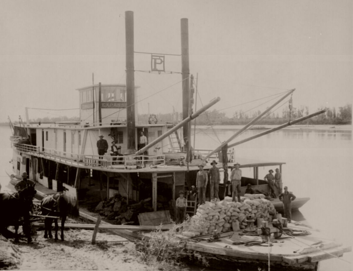 Steamer Expansion makes weekly trips on the Yellowstone River between Mondak and Glendive, Montana. The riverboat also carried freight for the lower Yellowstone reclamation project. August 9, 1907.