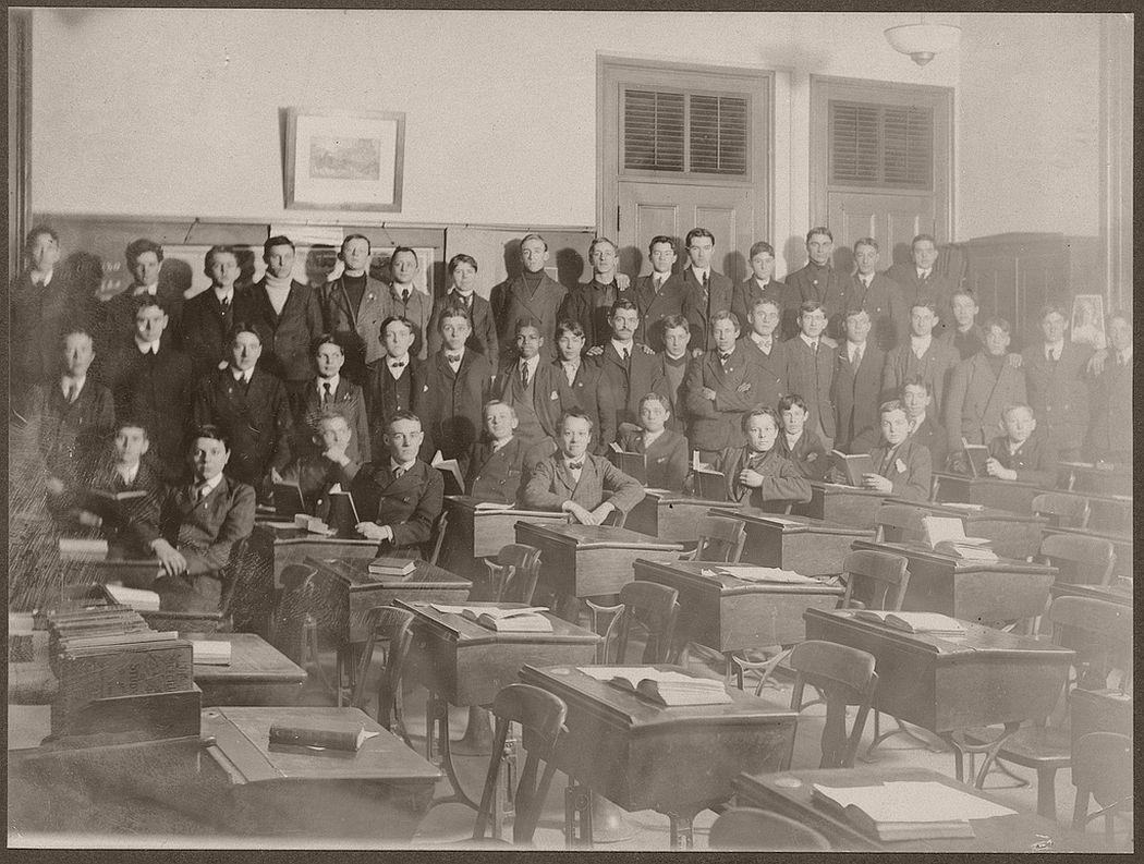 Male students pose for photographing