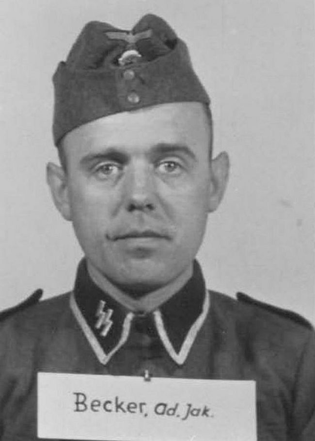 Adolf Becker, former watchmaker and optician. Joined SS in 1934 and reached the highest enlisted rank of Hauptscharführer (Head Squad Leader).