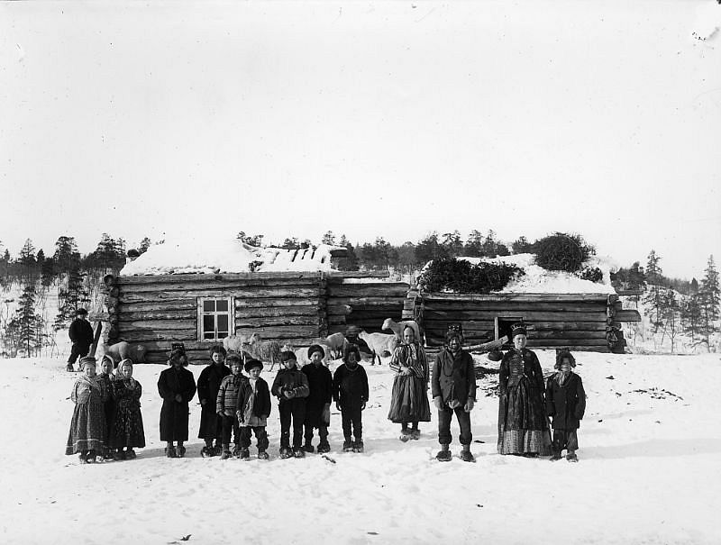 Adults and children photographed in front of a large house, Boris Gleb