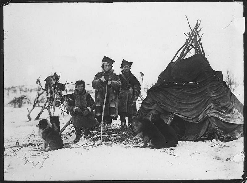 Samer with dogs outside the tent, Sør-Varanger
